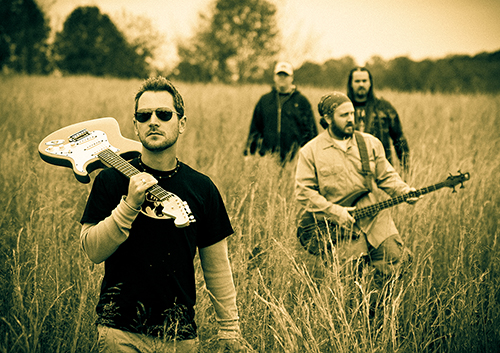 Portrait of a Band Walking Through a Field