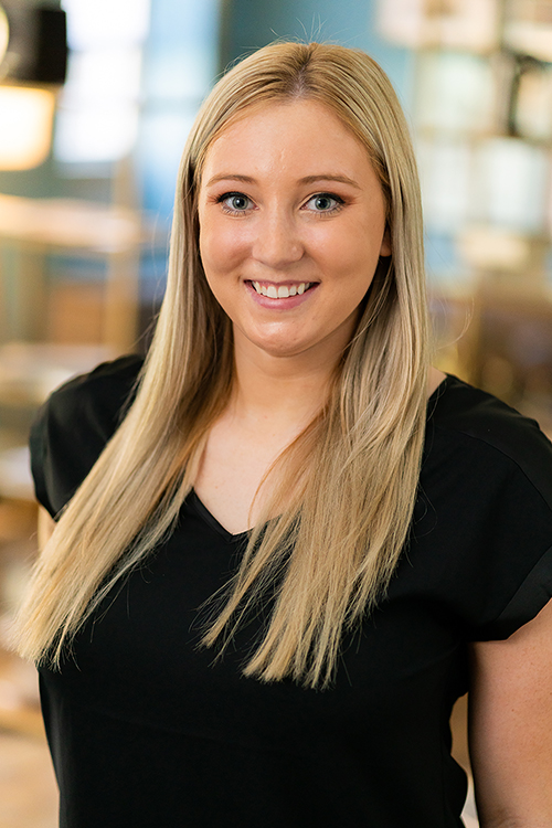 Headshot of a young commercial realtor