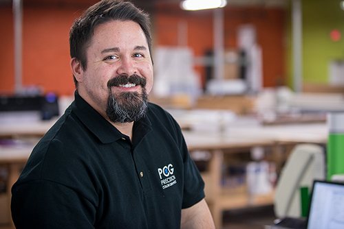 Headshot of a print shop manager