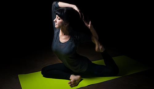 Portrait of a Yoga Instructor Making a Pose